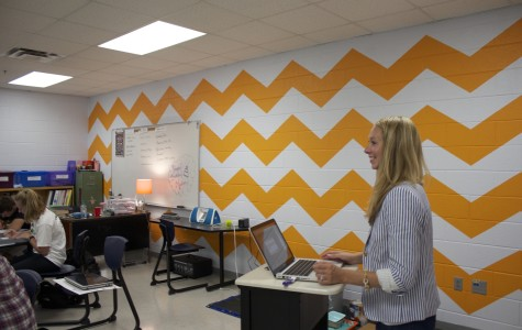 SGA students painted Mrs. Rebecca Nutter's room a trendy orange and white chevron.