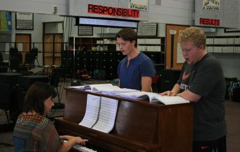 Junior Dalton Kizer (left) and senior Zane Gray (right) rehearse for musical theatre with chorus teacher Ms. Mary Sexton.