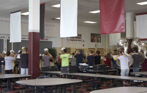 The band practices in the cafeteria as they get ready for their first performance of the year later this week.