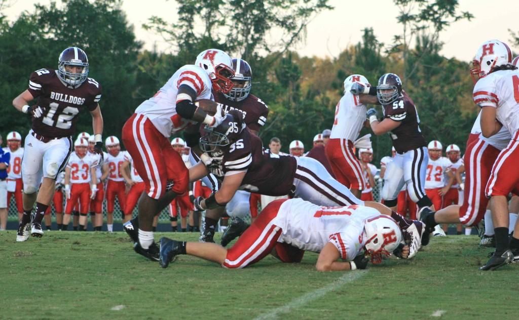 Kole Matherly (35) collects a tackle against Heritage in the Bulldogs' 54-28 win on Friday.