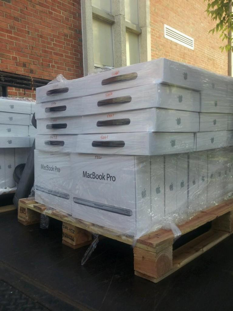 The first truck of MacBook Pros delivered its shipment Wednesday. Distribution begins Sept. 24.