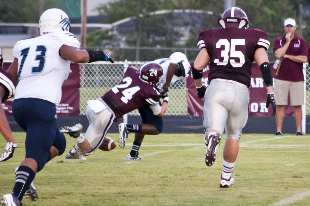 Former Bearden safety Ethan Pollack (24) makes a tackle in last year's 42-7 Bearden win against HVA. Kole Matherly (35) and Co. are hoping for another blowout win this year.