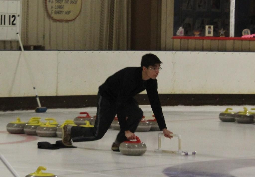 BHS junior Adam Hasan practices curling at the Ice Chalet.