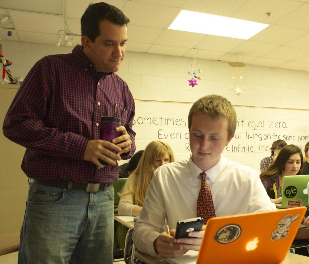 Bearden+math+teacher+Mr.+Richard+Robinson+works+with+senior+Bryce+Edwards+in+a+flipped+classroom+scenario.