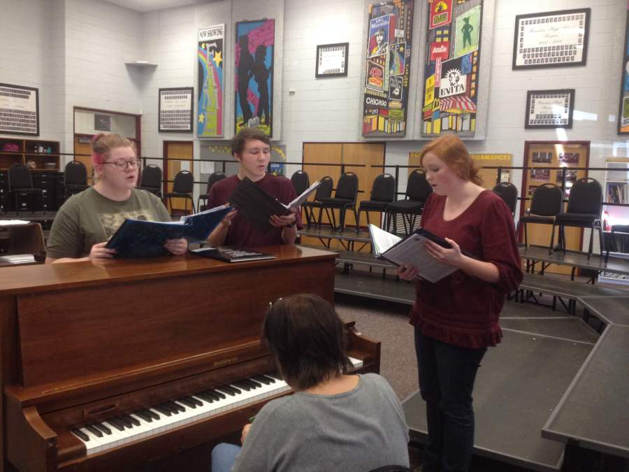 Students+rehearse+with+chorus+teacher+Ms.+Mary+Sexton%2C+as+they+prepare+for+All-East+choir.