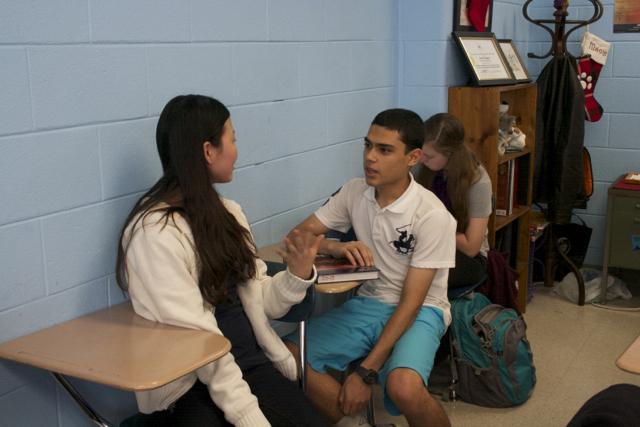 Bearden freshmen Priscilla Cho and Abdullah Salam work together in Mr. Sandy Hughes's Latin class.