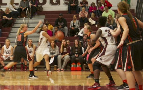 Anajae Stephney gets position in the paint, while Trinity Lee drives to the basket.