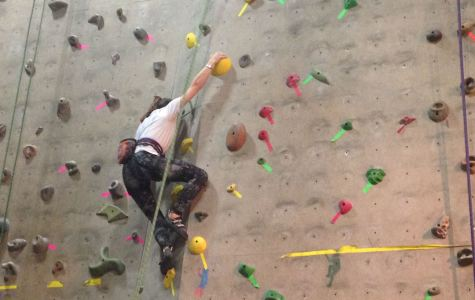 Junior Michaela Crenshaw climbs in a recent competition at RiverSports.