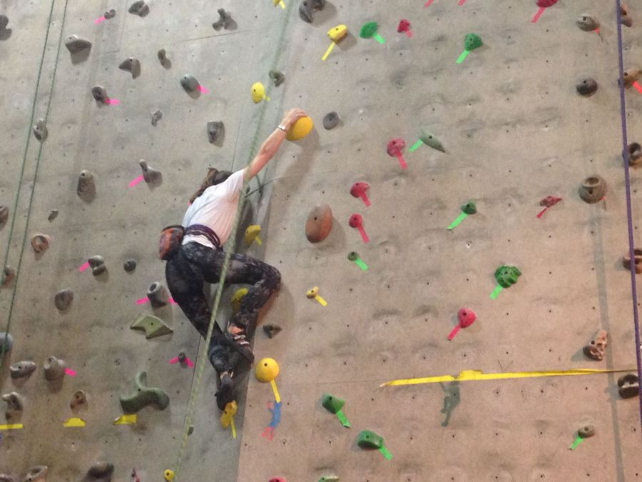 Junior+Michaela+Crenshaw+climbs+in+a+recent+competition+at+RiverSports.