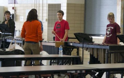 Mrs. Megan Christian prepares for the holiday concert with her percussionists.