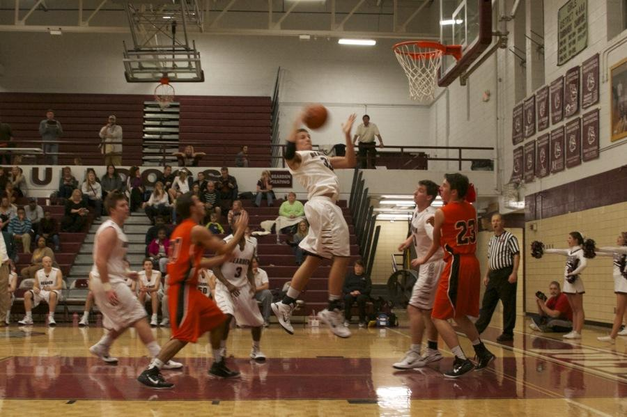 Junior+Jason+Smith+pulls+down+a+rebound+during+Bearden%27s+70-41+win+over+Lenoir+City+on+Tuesday.