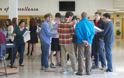 Ms. Mary Sexton (left) works with a group of Bearden Singers during school.