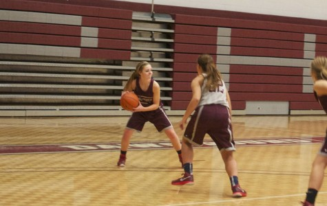 Holly Hagood runs the point during practice, while being guarded by freshman Kendall Clark.