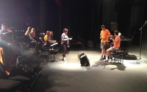 Seniors Adam Fulcher and Dalton Kizer rehearse for Coffeehouse with Ms. Mary Sexton.