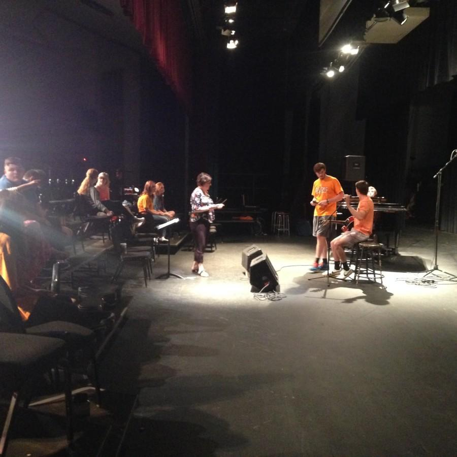 Seniors+Adam+Fulcher+and+Dalton+Kizer+rehearse+for+Coffeehouse+with+Ms.+Mary+Sexton.