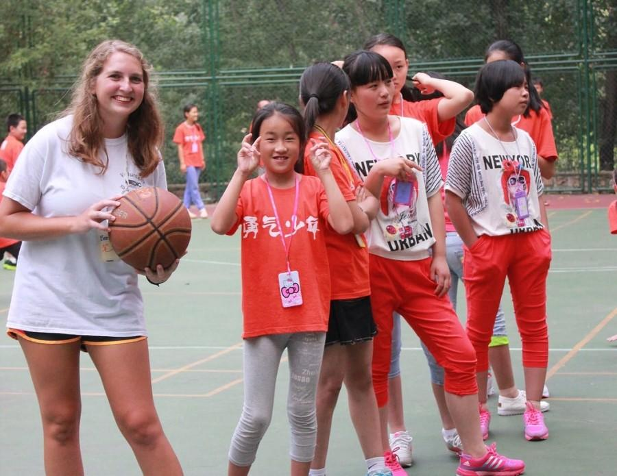 Bearden senior Elizabeth Steimer plays basketball with some of the kids at the summer camp.
