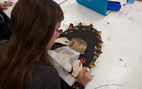 Bearden junior Natalie Campbell prepares artwork for Friday's Uncommon Core art show.