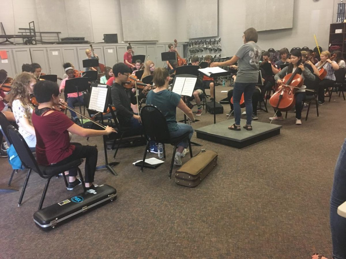 Mrs. Cynthia Wright conducts Bearden's orchestra, who are rehearsing for this week's fall concert.
