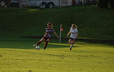 Junior Abby Brewer controls the ball against West earlier this season.