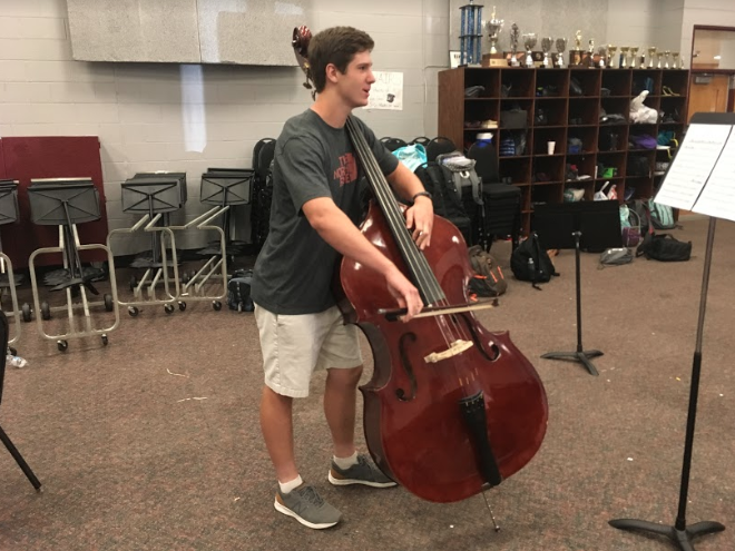 Mac Chandler plays the bass for Bearden's orchestra and has joined local band Stonefish – all while also starting for Bearden at linebacker.