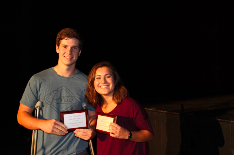 Mac Chandler and Julia Pelot hold up their Best All-Around awards from Annual Skits on Tuesday.