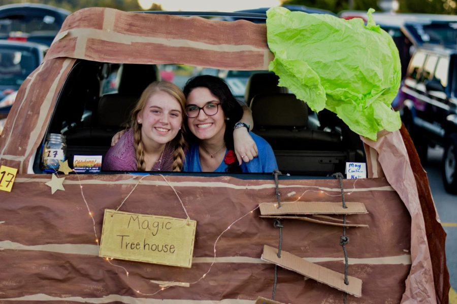 Seniors Bridget Greer and Lilly Sitver pose for a picture in their decorated trunk at last year's festival.