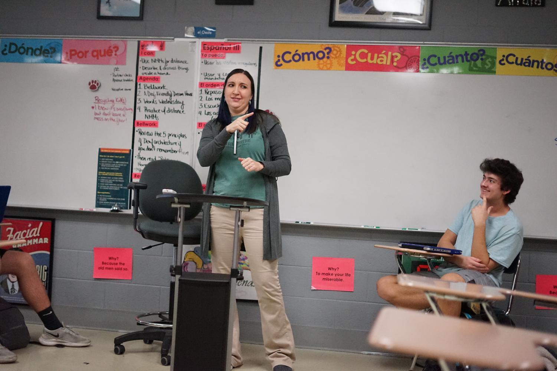Sophomore Mikayil Birdal laughs as ASL teacher Ms. Karen Latus cracks a joke during class.