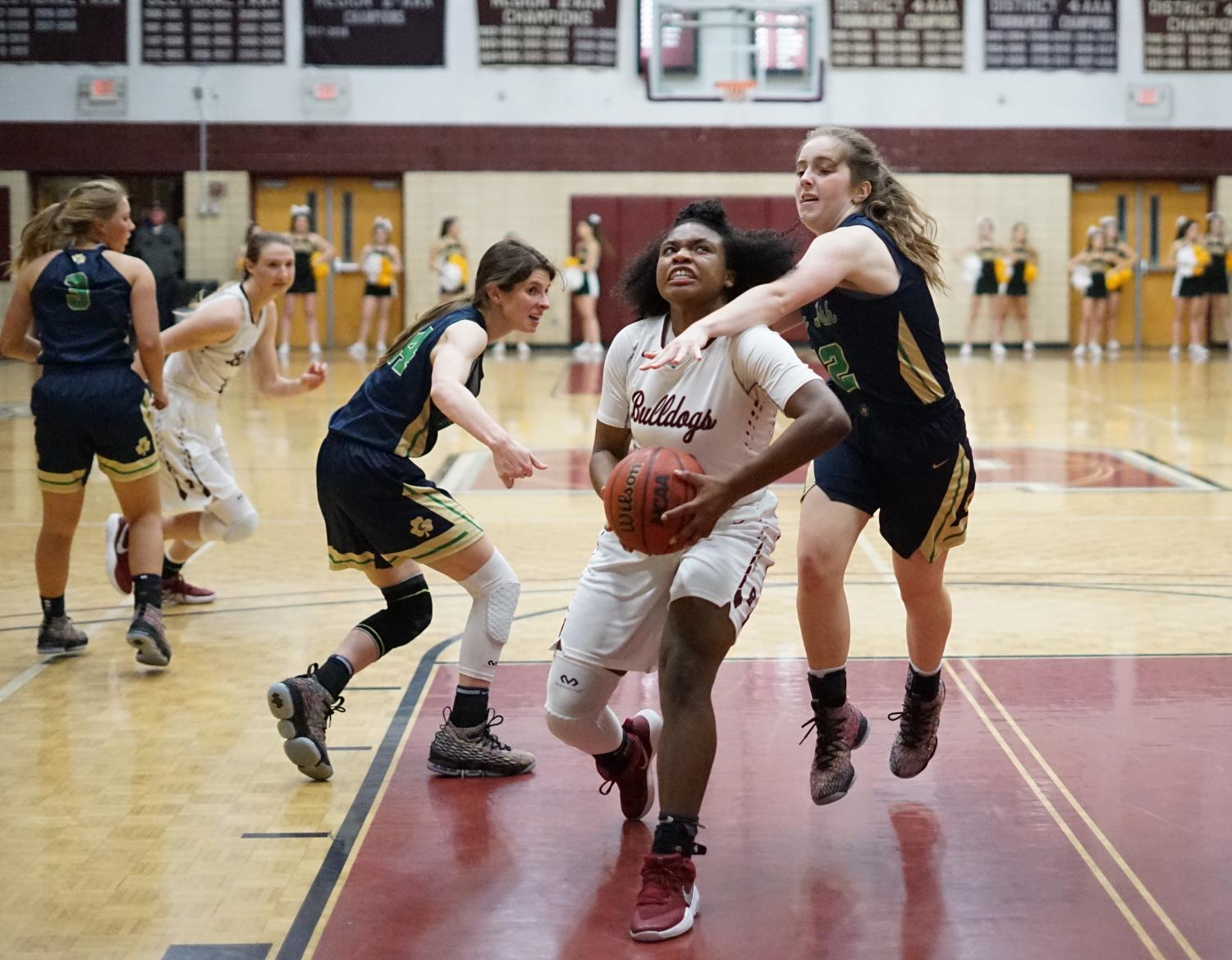 Tytiaira Spikes drives toward the basket in a recent win against Catholic.