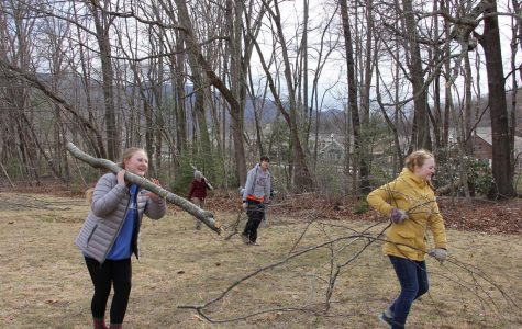 Maitlyn Phillips (left) and Lydia Steimer (right) work on last year's service project at Black Mountain Home.