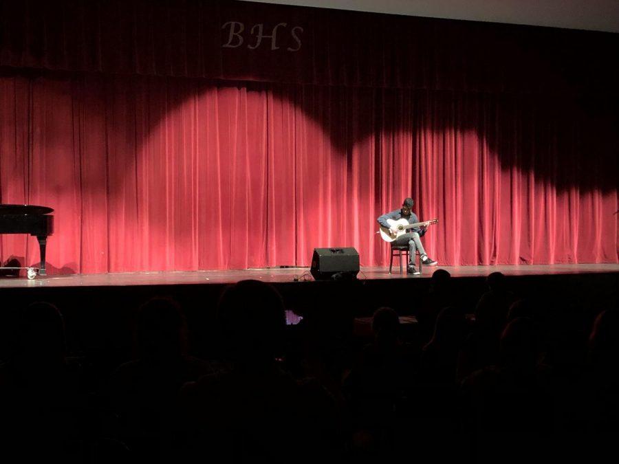 Senior Ahmadi wins talent show with Spanish guitar medley