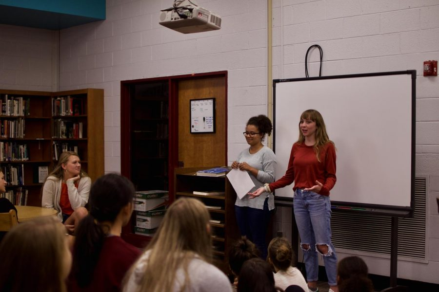 SGA president Abby Ann Ramsey (right) and new member coordinator Tiana Sprowls (left) present to SGA members at a meeting after school last week.