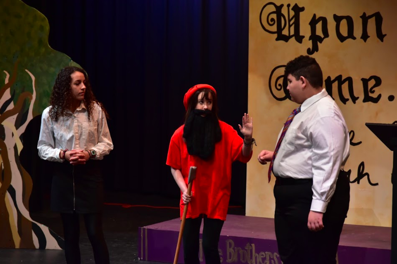 Narrators Reagan Ruth (left) and Javier Castro (right) talk to Megan O'Neal, one of the seven dwarfs.