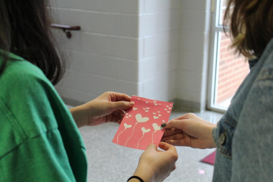 NAHS+students+look+over+their+work+for+the+club%27s+Valentine%27s+Day+card+fundraiser.