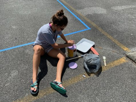 Senior Kate Myers was inspired by the show Friends for the design of her painted parking space.