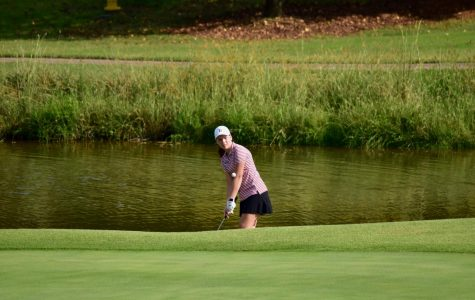 Junior Sydney Branson watches her chip shot during a tournament last year. She along with the rest of the girls team have advanced to next week's region tournament.