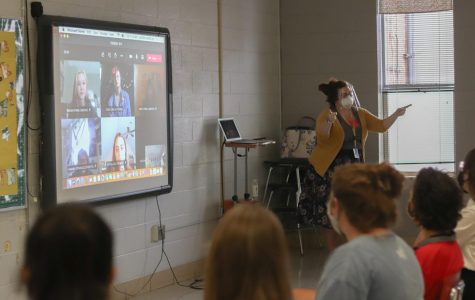 Mrs. Lauren Andrejko works with her blended stage tech class of virtual and in-person students.