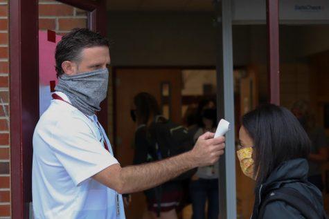 Mr. Donald Balcom takes a student