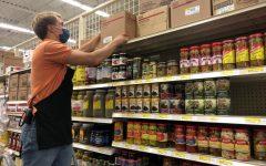 Senior Kameron Seagrist stocks the shelves.