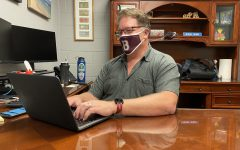 Mr. Russ Wise works in his office in the East Mall. Mr. Wise came to Bearden from Central High School.