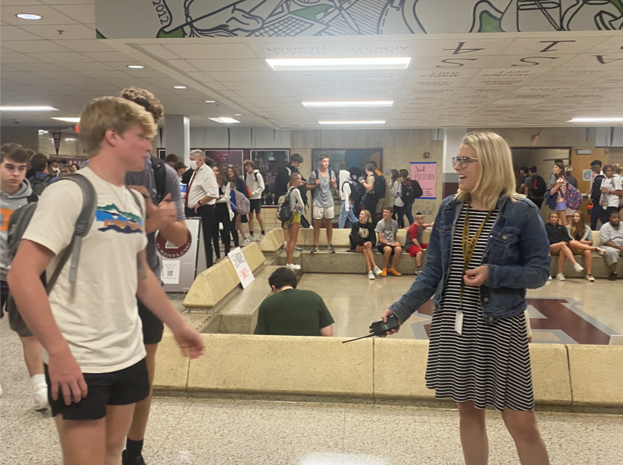 Assistant+principal+Mrs.+Denise+Watts+greets+junior+Brady+Frederick+during+class+change.