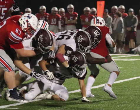 Kam Smith (92) makes a play in the backfield against Jefferson County last year.