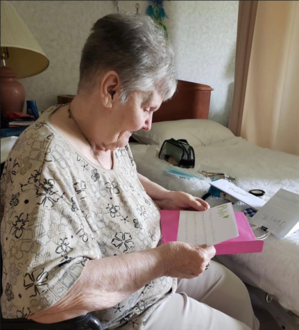 A resident who lives in a nursing home reads one of the letters she has received through the Letters for Rose organization.
